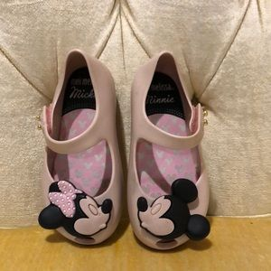 Mini Melissa kissing Minnie and Mickey shoes.,
